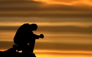 praying-and-kneeling-man
